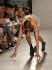 A model trips and falls during the Proenza Schouler spring 2007 runway show during Fashion Week in New York.